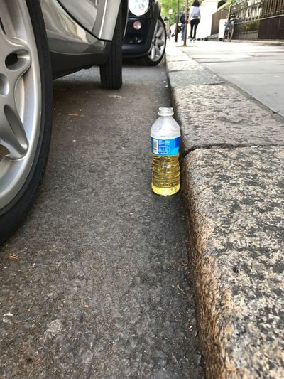 #Urine in bottle in along a road side car park, #city life, 4245035