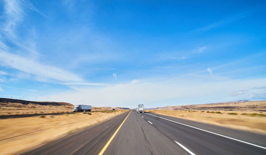 Transportation Road Sky Landscape Direction The Way Forward Cloud - Sky Environment Nature Land Vehicle Symbol Road Marking Land Mode Of Transportation Day Highway Motor Vehicle Marking Car Sign No People Diminishing Perspective Outdoors Dividing Line Arid Climate