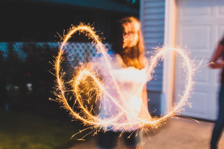 Outdoors Fireworks Sparks Sparkler Young Women Girl Celebration Design EyeEmNewHere Blurred Motion Sommergefühle Rethink Things