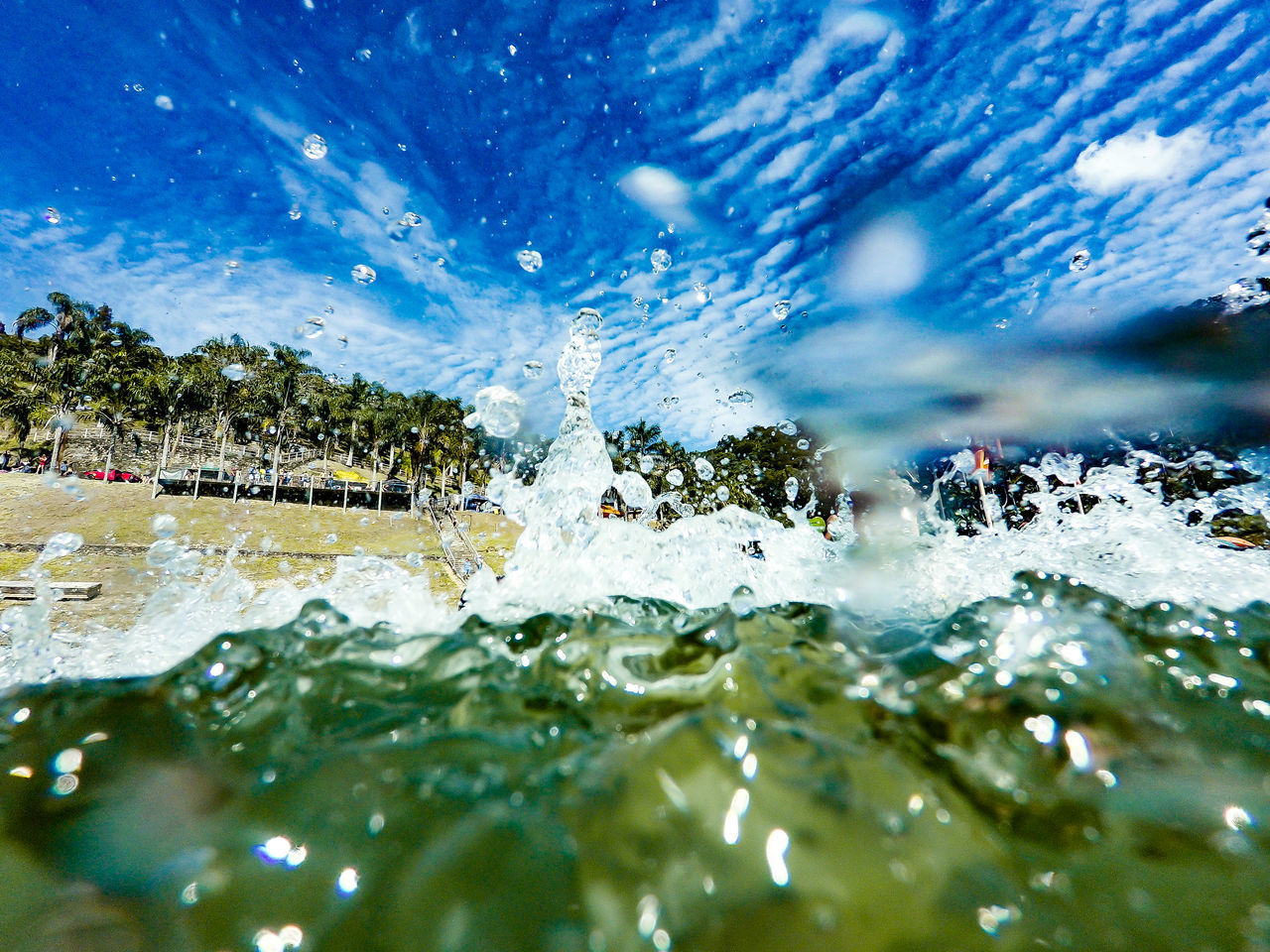 water, motion, nature, sport, sea, day, outdoors, splashing, scenics - nature, blue, beauty in nature, rock, no people, travel destinations, selective focus, solid, land, sunlight, cold temperature, swimming pool, surface level