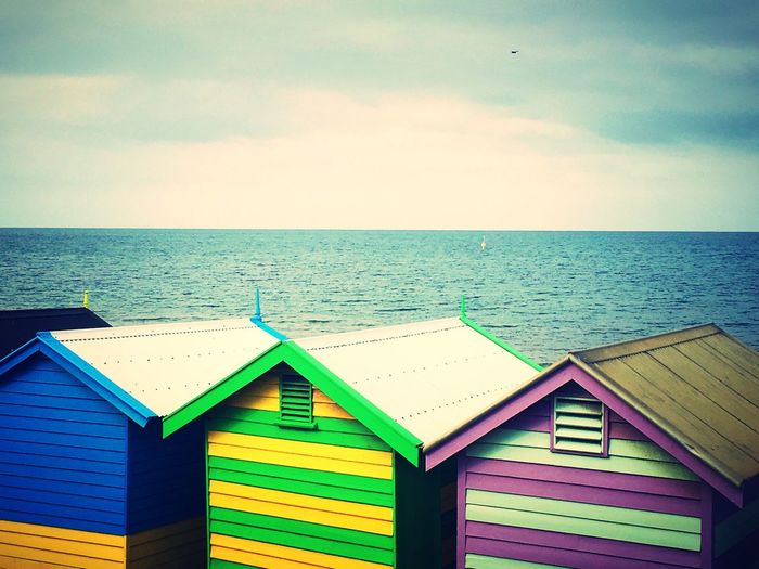Melbourne Australia Beach Sea Water Horizon Over Water Sky Built Structure Multi Colored Day Architecture Outdoors House Beach Hut Painted Roof Row Vibrant Color Vibrant Bright Bright Colors Stripes Summer EyeEm Gallery Taking Pictures