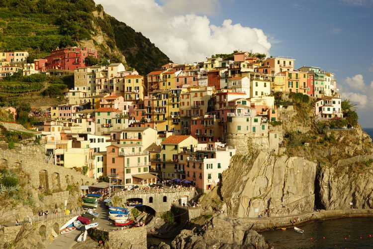 Architecture Building Exterior Built Structure Casual Clothing Cinque Terre City City Life Cliffside Cloud - Sky Development High Angle View House Liguria,Italy Manarola Mode Of Transport Mountain Outdoors Person Residential Building Residential District Sky Sunny Tourism Transportation Travel Destinations
