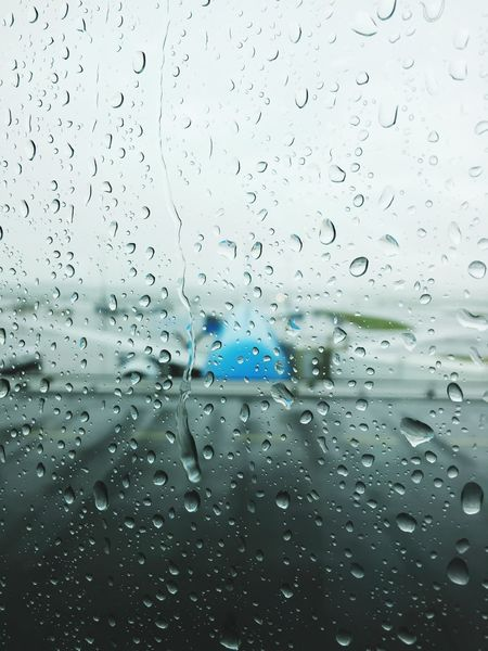 Planes fly no matter what is the weather. Rain Water Wet Drop Window RainDrop No People Raindrops Rainy Days Rain Rainy Day Rainy Window Window View Windowview Window Art Airplane Airport Aircraft Holland Schiphol Schipolairport