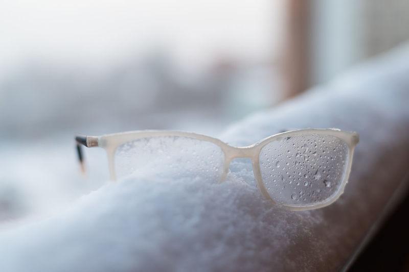 Close-up of eyeglasses on snow