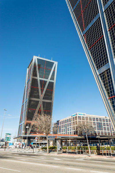 Leaning towers office building in Madrid against blue sky Business Financial District  Kio Madrid Modern Architecture SPAIN Blue Sky Clear Sky Day Downtown District Landmark Leaning Leaning Tower No People Office Building Office Building Exterior Outdoors Skyscraper Tower