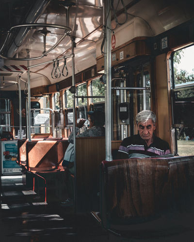 Portrait of man sitting in bus