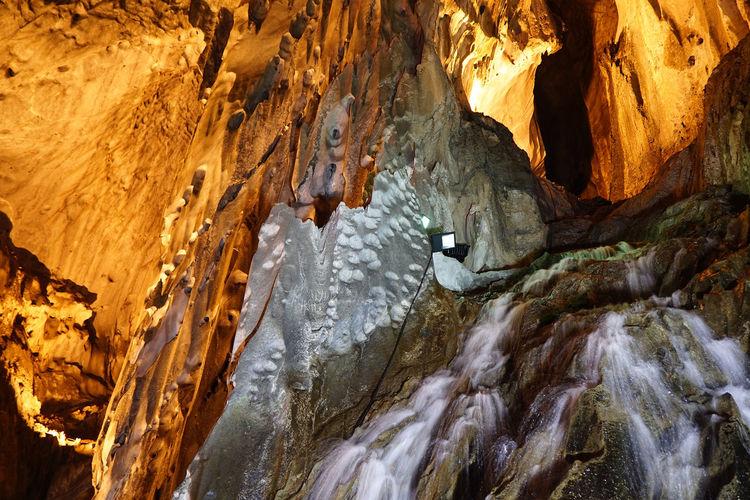 Waterfall at illuminated batu caves