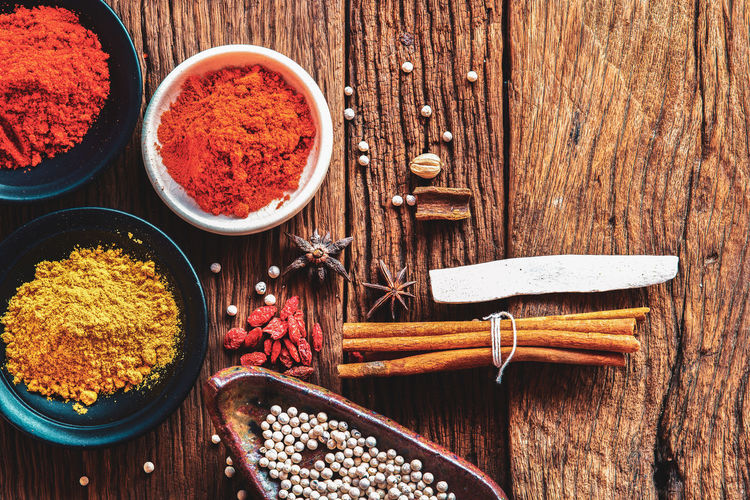 Food ingredient, Powder spices on cup in on old wood table background Spice Wood - Material Food Ingredient Freshness Table Vegetable Bowl Chili Pepper No People High Angle View Pepper Red Ground - Culinary Herb Cardamom Paprika Spicy