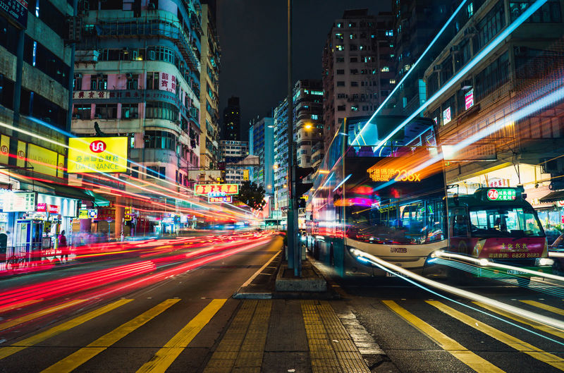 Hong Kong Nights - may the most probably say it's to colorful and looks spotty, but this one is just real - it's Hong Kong, Wowlooon. Building Exterior City Architecture Illuminated Built Structure Motion Long Exposure Transportation Speed Light Trail Night Blurred Motion Street Road Building City Life Mode Of Transportation No People City Street Multi Colored Outdoors Hong Kong Kowloon, HK City Lights Street Lights