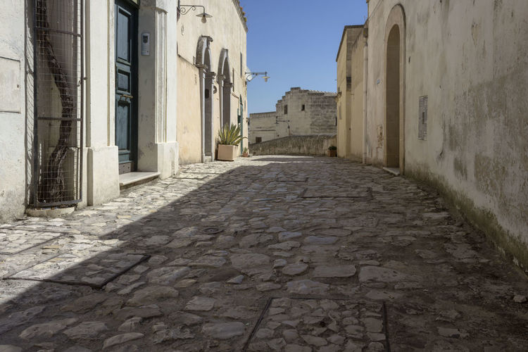 Matera Italy Basilicata South Italy Nobody UNESCO World Heritage Site Architecture Building Exterior Built Structure Building Direction The Way Forward Sky No People City Nature Street Narrow Day Alley Footpath Outdoors Entrance Door Sunlight Residential District Diminishing Perspective Long Surface Level