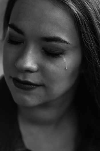 Close-up of sad young woman crying
