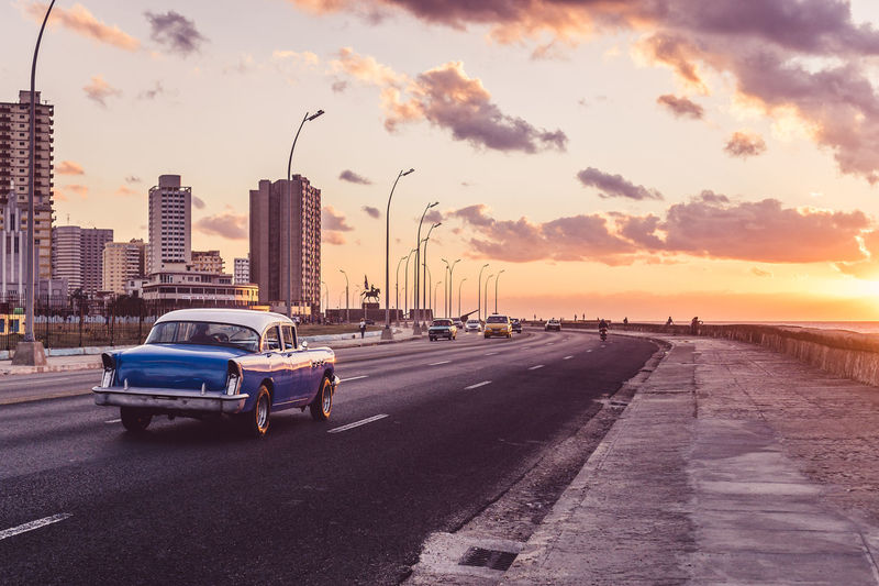 Malecón, Havana, Cuba The Traveler - 2018 EyeEm Awards This Is Latin America Architecture Car City City Life Cityscape Cuba Driving Enjoying The View Havana Light And Shadow Old Car Road Skyscraper Sommergefühle Sunlight Sunset Sunset_collection Taking Photos Transportation Urban Vintage Vintage Car Been There.
