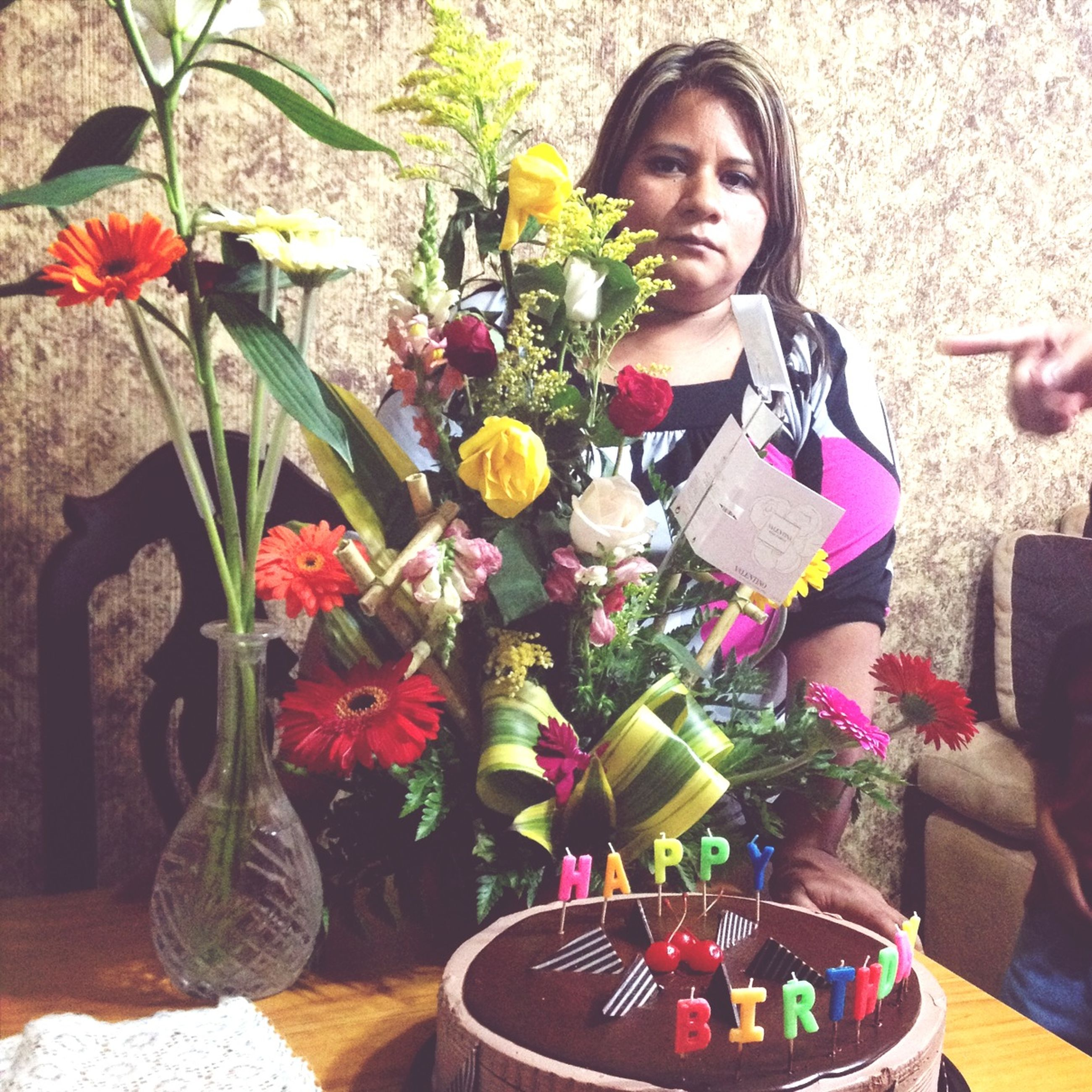 lifestyles, flower, leisure activity, freshness, casual clothing, table, person, holding, sitting, food and drink, indoors, elementary age, childhood, standing, front view, girls, smiling, bouquet