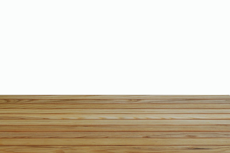 Close-up of wooden floor against wall