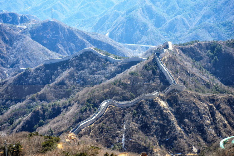 Great Chinese wall in the mountains near Beijing ASIA Ancient Badaling Beijing Panorama Border Brick China Culture Forest Hill History Landscape Miracle Mountain Tourism Unesco Unesco World Heritage Wonder