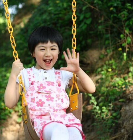 Child Swing Playground Girls One Person One Girl Only Park - Man Made Space Childhood People Happiness Black Hair Fun Smiling Beauty Outdoors Real People Human Body Part Portrait Schoolyard Close-up