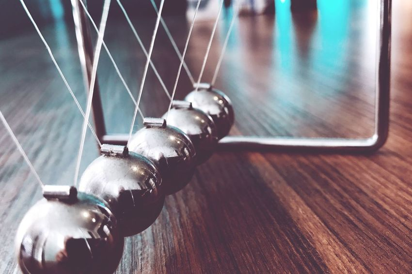 Neon Life Newton's Cradle Balls Balance Pendulum Indoors  Close-up No People Table Hanging Neon Lights Shiny Reflection Illuminated Silver  Game In A Row Perspective Sphere Toy Order Quiet Breathing Space