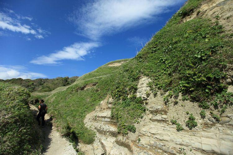 Lush Rocky Landscape Against Blue Sky