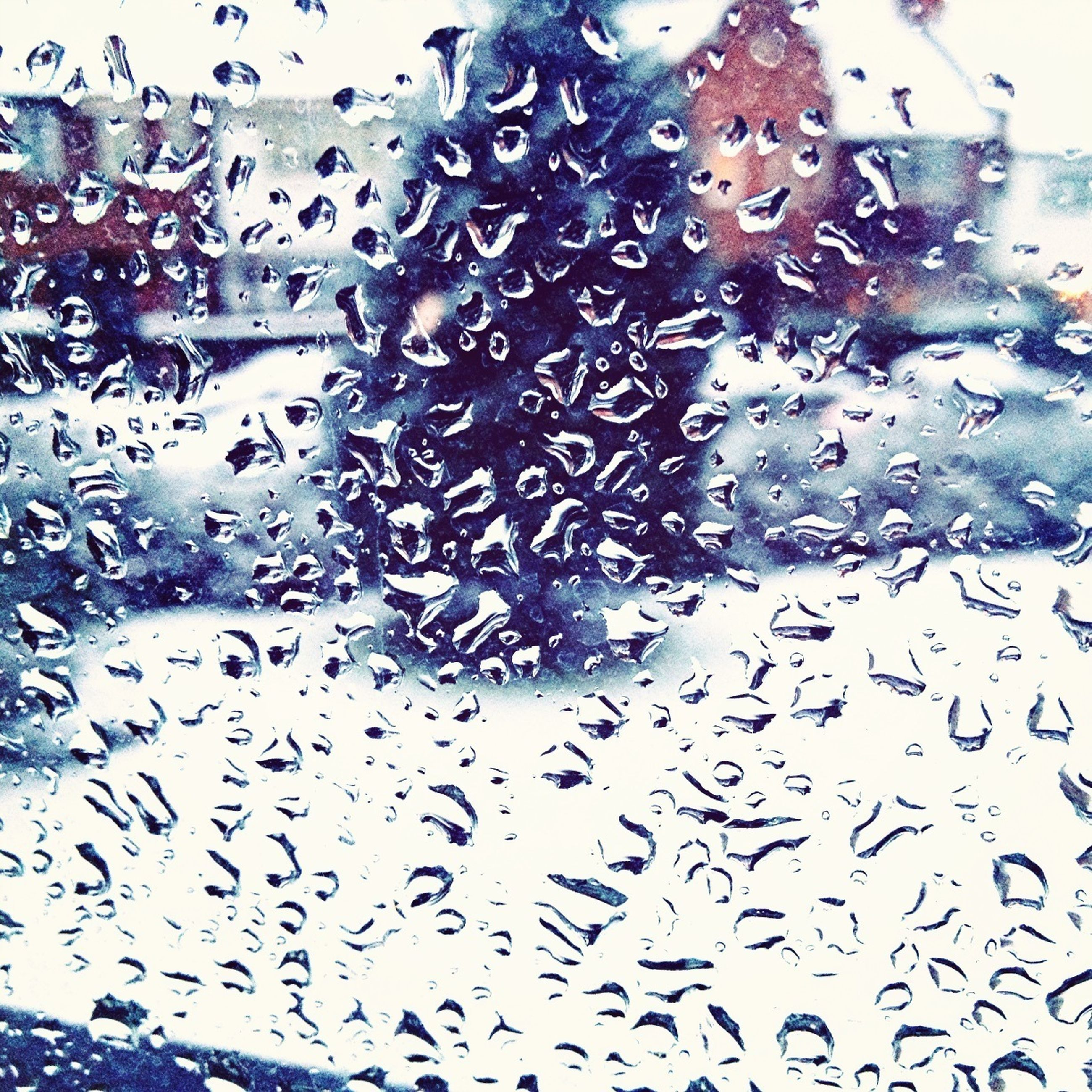 drop, wet, water, window, indoors, rain, glass - material, raindrop, transparent, season, full frame, backgrounds, weather, architecture, built structure, glass, close-up, pattern, building exterior, focus on foreground