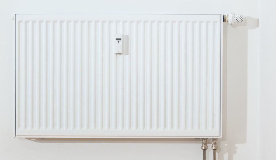 Close-up of white radiator on wall
