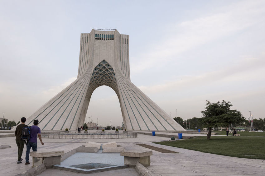 TEHRAN, IRAN - 7 May 2018 Tourist visiting Azadi Tower formerly known as the Shahyad Tower is a monument located at Azadi square and is a landmark of Tehran horizontal shot Architecture Built Structure Sky Travel Destinations Tourism Travel Men City Nature Incidental People The Past Day Building Exterior History Memorial Real People Group Of People People Monument Cloud - Sky Outdoors Azadi Tower In Tehran