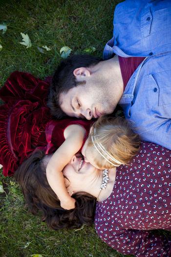 High angle view of couple lying on grass