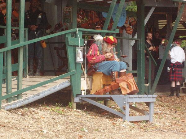Abundance Occupation Railing Real People Renaissance Renaissance Festival Retail  Sitting Wood Wood - Material