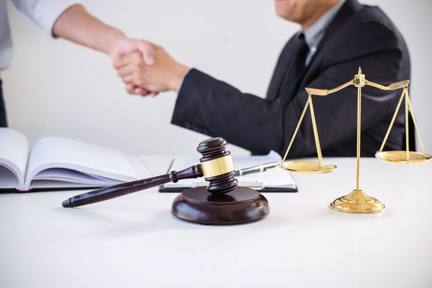 Lawyer Agreement Barrister Business Business Person Consultant Contract Counselor Fairness Hand Handshake Holding Human Hand Indoors  Judge Judgement Jumping Justice Legislation Men Occupation People Shaking Hands Two People Verdict