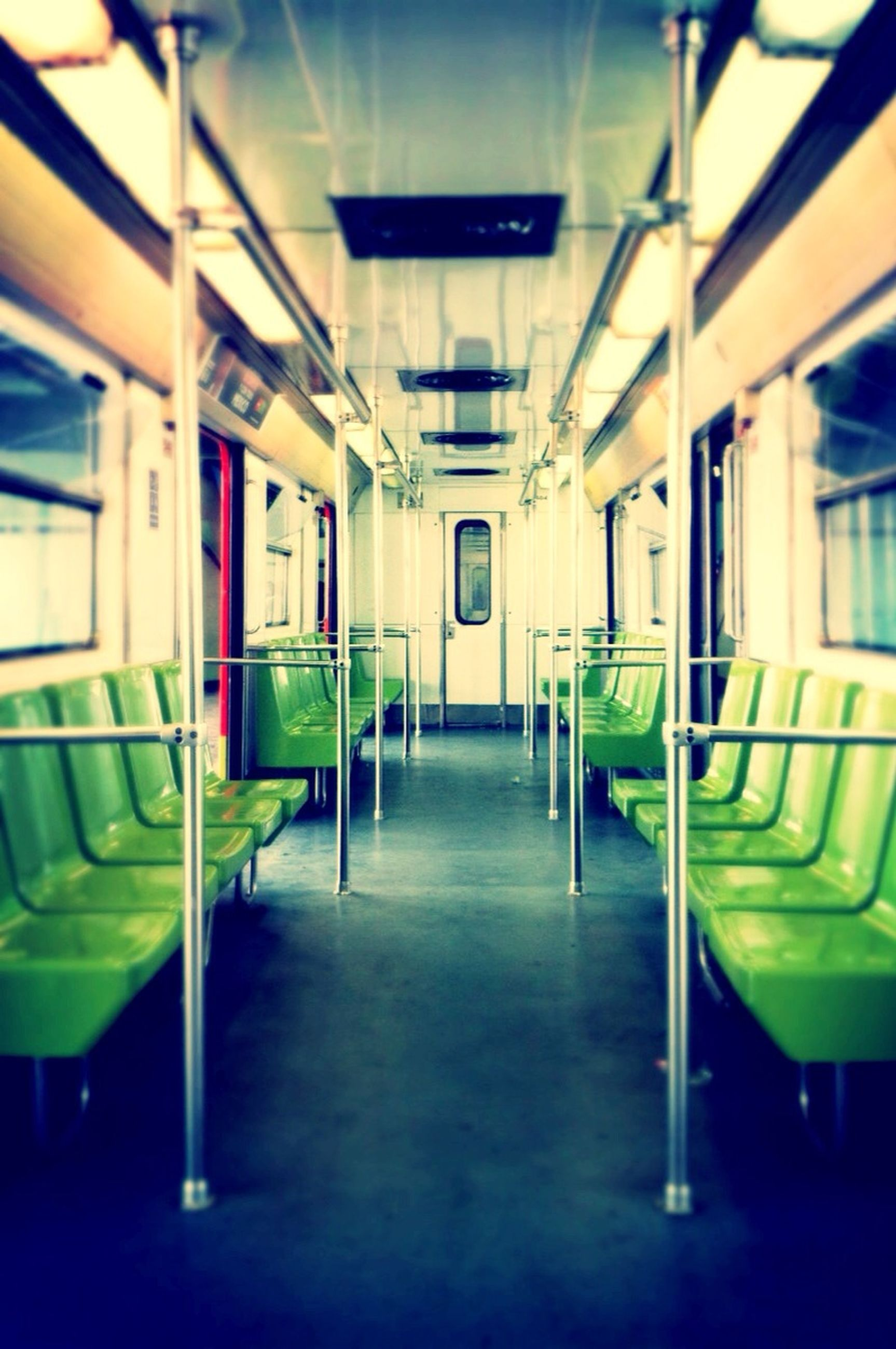 empty, indoors, transportation, built structure, absence, architecture, public transportation, mode of transport, window, in a row, public transport, no people, passenger train, chair, reflection, train - vehicle, seat, illuminated, day, interior