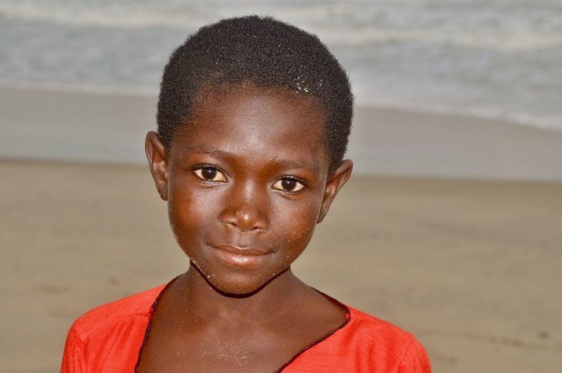 Close-up portrait of girl at beach