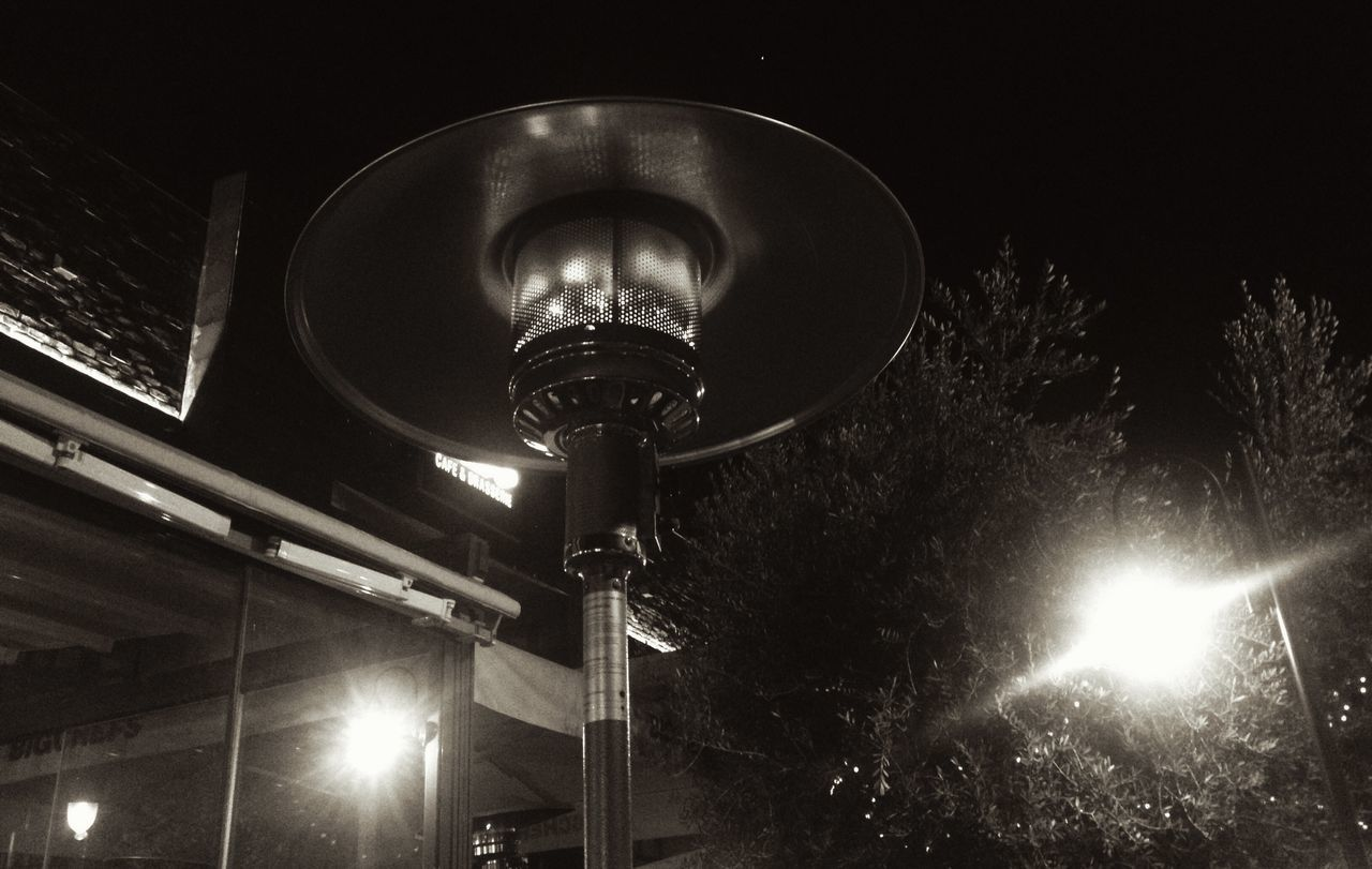 illuminated, lighting equipment, night, low angle view, street light, electric light, no people, light bulb, outdoors, electricity, light beam, architecture, sky, close-up
