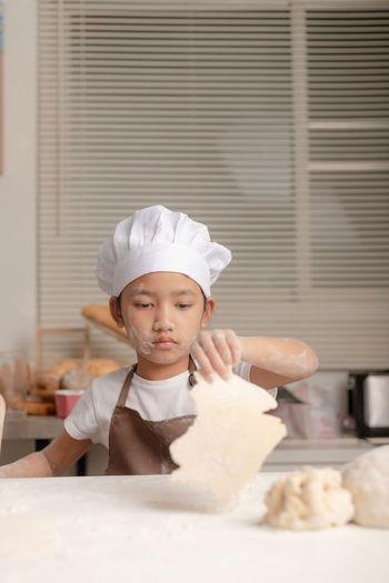 Portrait of boy with ice cream in kitchen