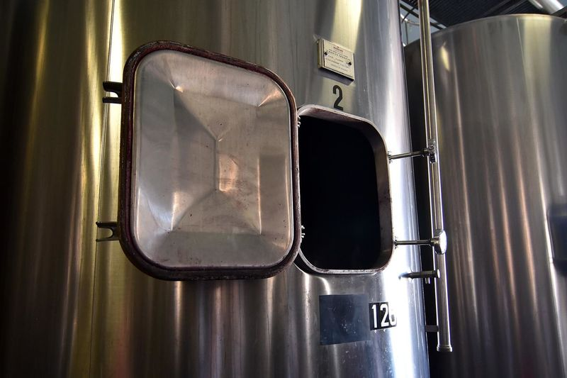 Open metallic storage tank at winery