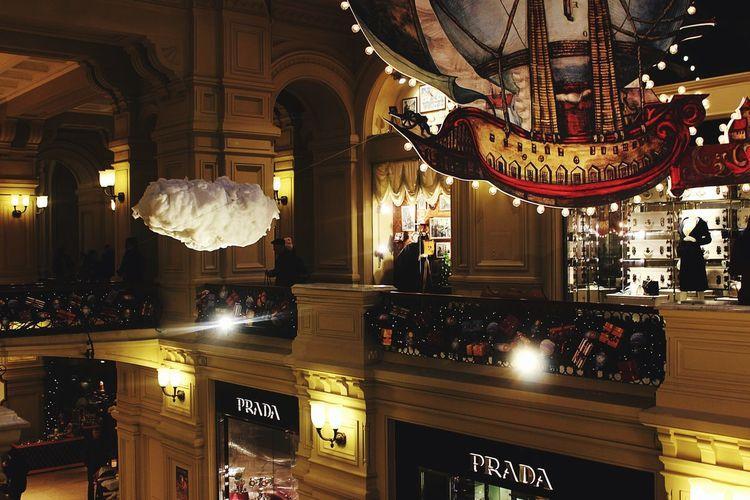 Illuminated lanterns hanging in store