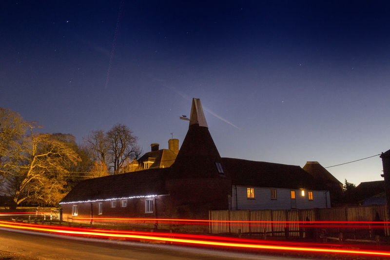 Busy Road at 4am in the morning, Oast House with Xmas lights, Lenham, Kent. Xmas Decorations Oast House Hops Beer Garden Of England Night Sky Tranquil Scene Travel Destinations Tourism Light Trail Night Illuminated Built Structure Motion Transportation Blurred Motion Clear Sky Building Architecture Dusk Building Exterior