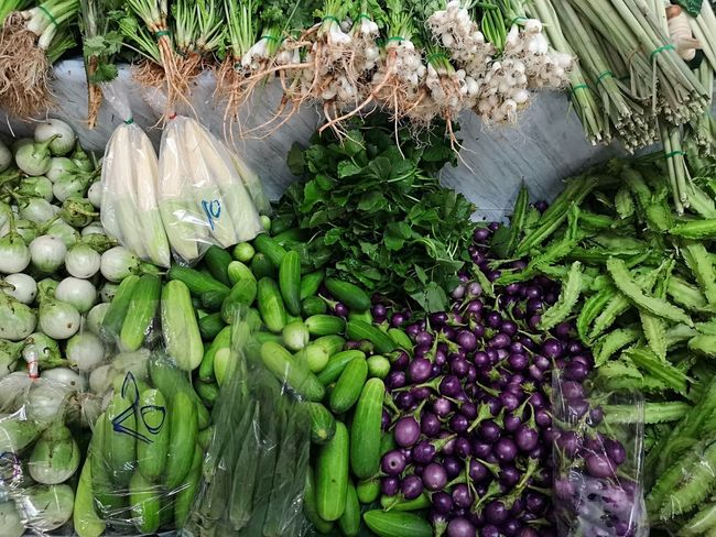 Market vender Green Violet Vegetable High Angle View Close-up Green Color Plant For Sale Raw Food Market Farmer Market Price Tag Street Market
