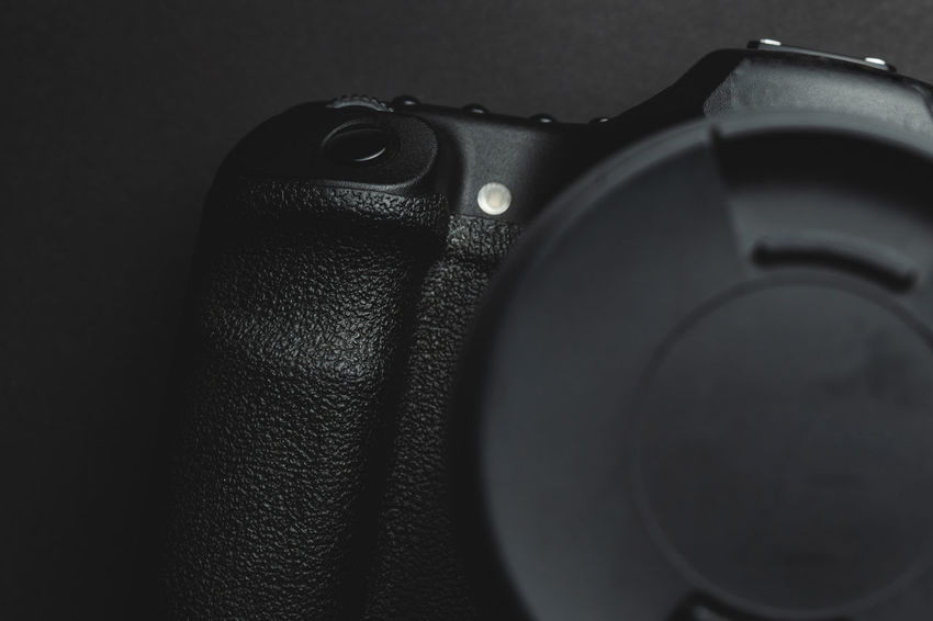 close up view of a DSLR camera in dark atmosphere Close-up Indoors  Technology No People Still Life Photography Themes Photographic Equipment Single Object Studio Shot Camera - Photographic Equipment Arts Culture And Entertainment Focus On Foreground Black Color Textile Music Leather Selective Focus Protection Personal Accessory Digital Camera Grip DSLR Shutter Photography Photographer