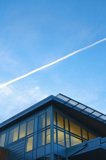Architecture Building Exterior Built Structure Contrail Day Low Angle View No People Outdoors School Sky Vapor Trail White Window
