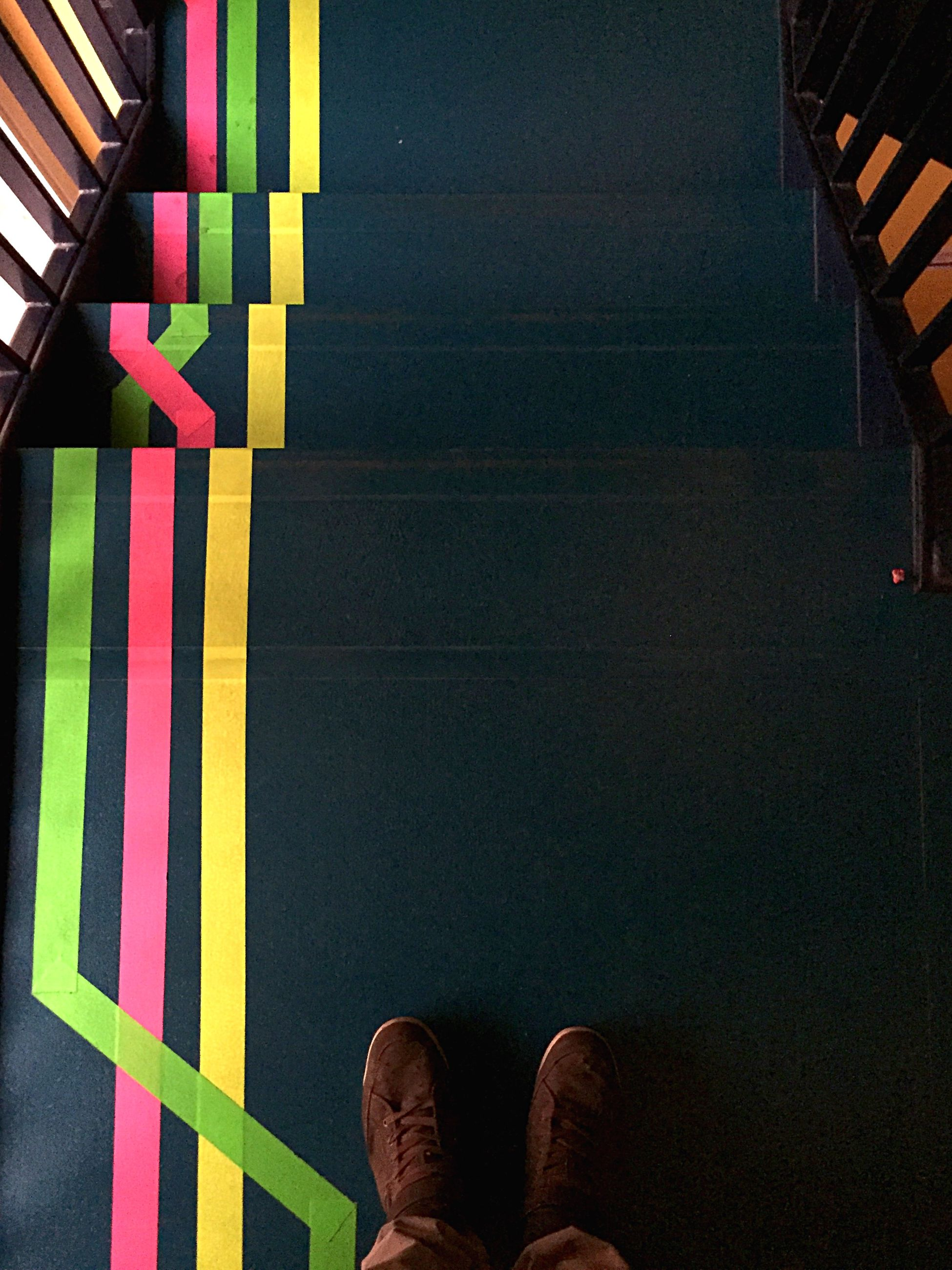 low section, person, personal perspective, shoe, human foot, high angle view, standing, part of, footwear, unrecognizable person, indoors, lifestyles, men, railing, steps, blue, flooring