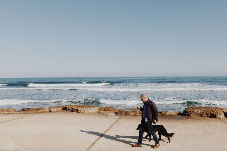 The KIOMI Collection Showcase April Hanging Out Relaxing Two Is Better Than One Enjoying Life Water Sea Israel Eye4photography  Springtime EyeEm Best Shots Summer Spring Beach Sky Urban Lifestyle Waves Surfing Blue Wave Man Dog Walk The Street Photographer - 2016 EyeEm Awards Urban