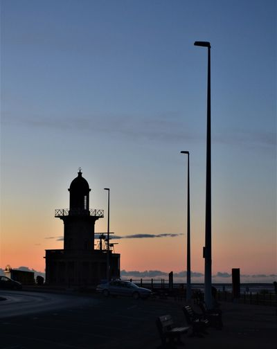 Lower Lighthouse at Fleetwood with red, pink, orange and blue skies at sunset in winter. Sky Sunset Built Structure Tower Architecture Building Exterior Street Light Silhouette Orange Color Street Nature No People Transportation Lighting Equipment Guidance Building Mode Of Transportation Sea Security Direction Outdoors Lighthouse Fleetwood Lower Lighthouse