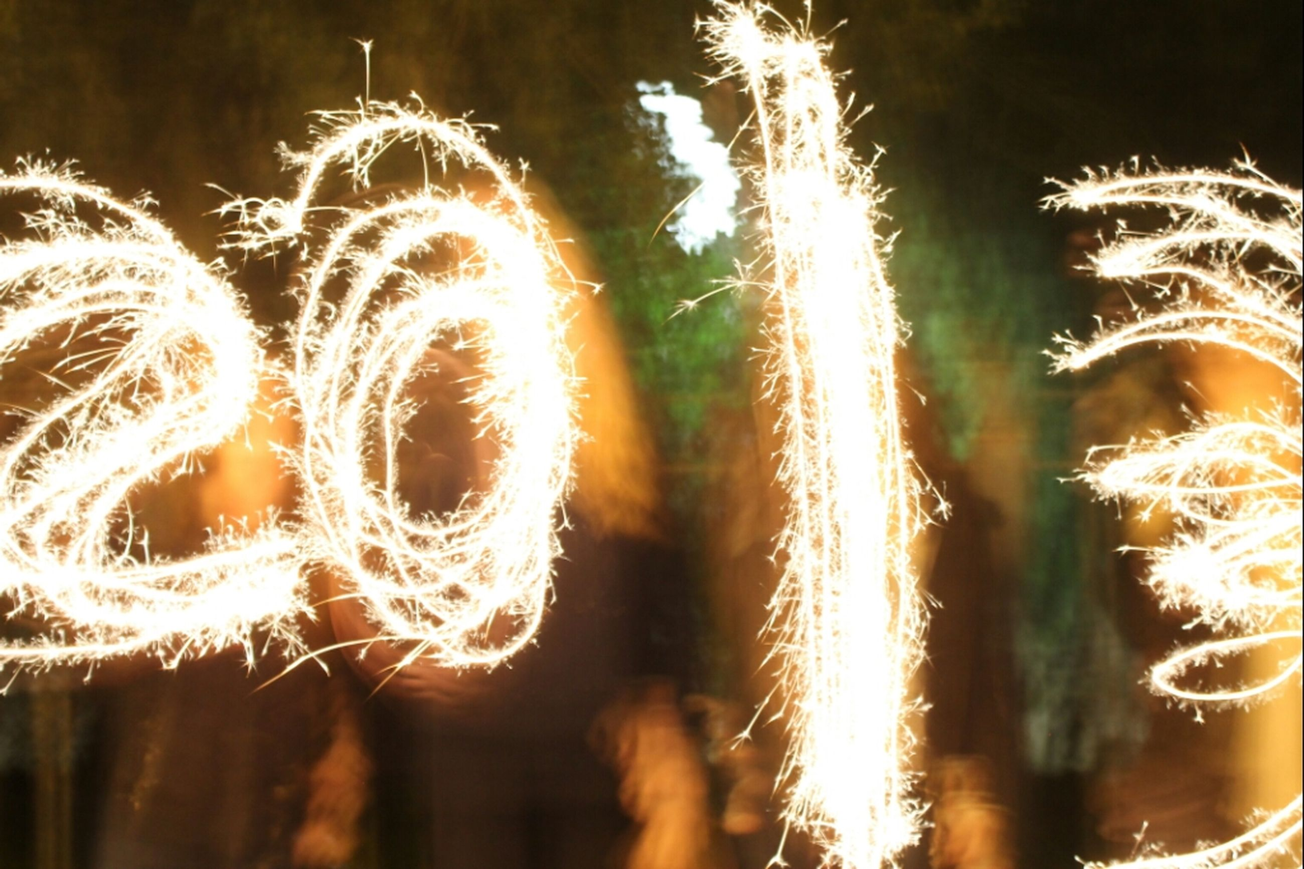 illuminated, night, long exposure, growth, glowing, blurred motion, celebration, outdoors, arts culture and entertainment, nature, yellow, close-up, firework display, motion, sparks, sky, no people, focus on foreground, multi colored, beauty in nature