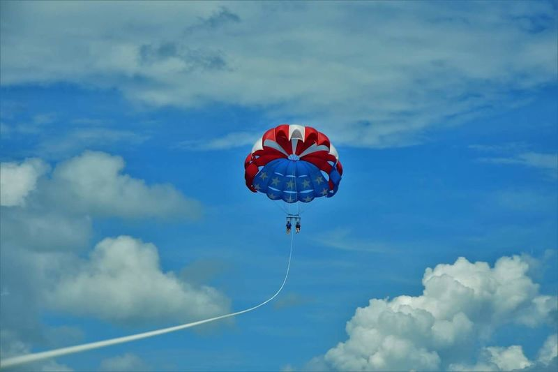 EyeEm SelectsMy daughter and I parasailing on vacation in Florida. Mid-air Cloud - Sky Sky Flying Parachute Blue Outdoors Day Adventure Low Angle View Airshow Extreme Sports Aerobatics Hot Air Balloon No People Vacation Time ♡ Tranquility Summer Relaxation Sea Beach