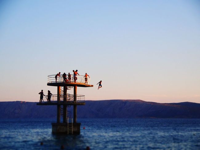 Water Clear Sky Men Full Length Togetherness Sunset Women Lake Mature Men Place Of Worship Lakeshore Diving Platform Water's Edge Standing Water Coastline Countryside Waterfront Seascape Floating On Water Whistler Freshwater Lakeside Shrine
