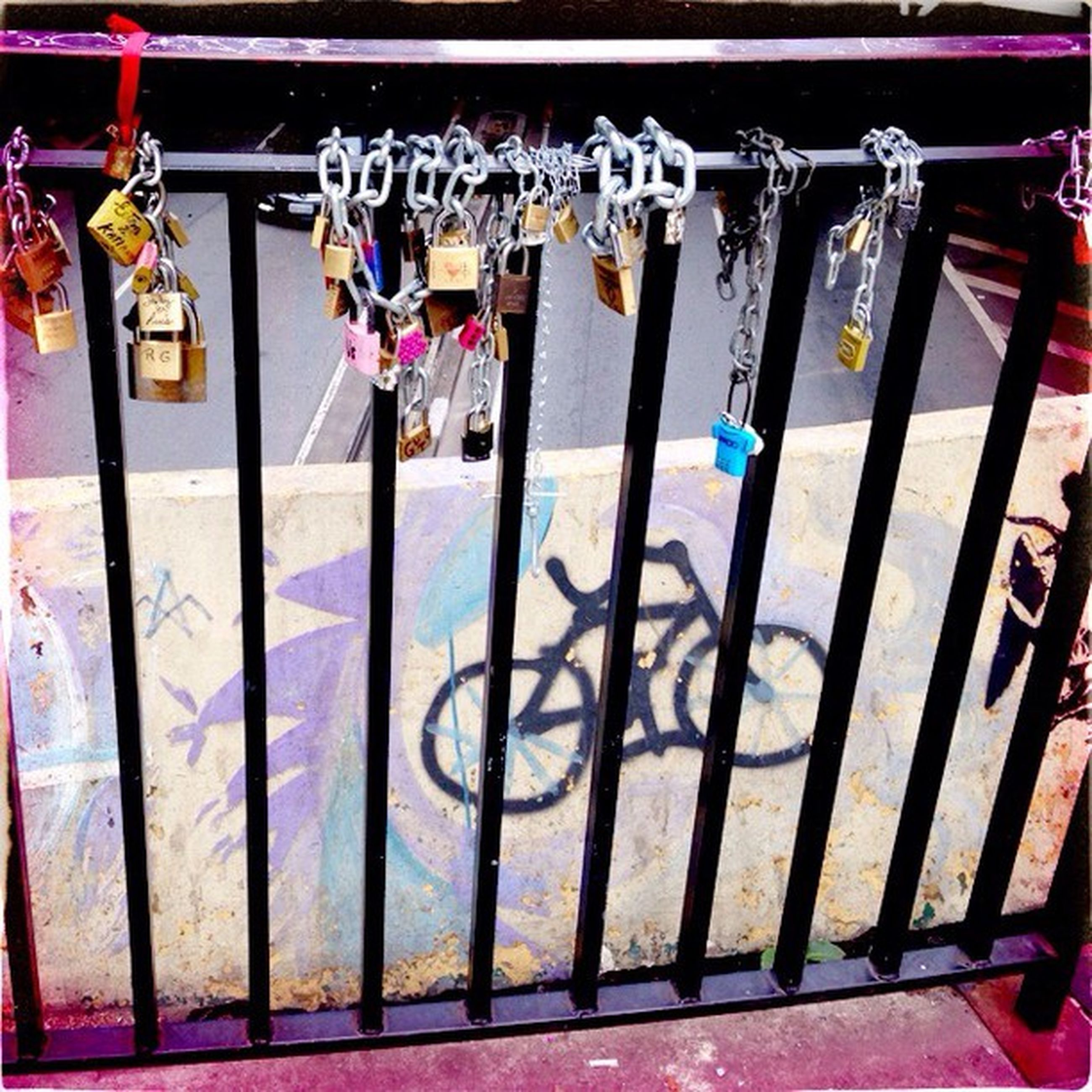 multi colored, graffiti, wall - building feature, art, creativity, art and craft, hanging, text, built structure, metal, architecture, wall, day, railing, fence, western script, protection, sunlight, street art, no people