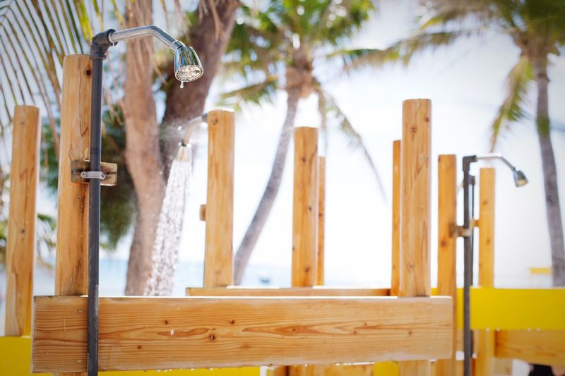 Low Angle View Of Showers By Wooden Structure