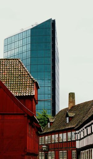 Minimalist Architecture The Old Town århus The Old Town Aarhus Aarhus, Denmark Old Architecture Old City Angles And Views Building Exterior Architecture Built Structure Roof City Low Angle View Day No People Sky Outdoors Skyscraper Denmark Architecture Angle And Perspective Juxtaposition Old Vs Modern Old Vs New EyeEmNewHere