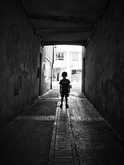 Boy standing in tunnel