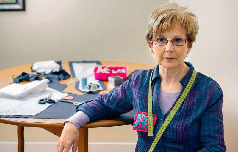 Portrait of mid adult woman wearing eyeglasses on table