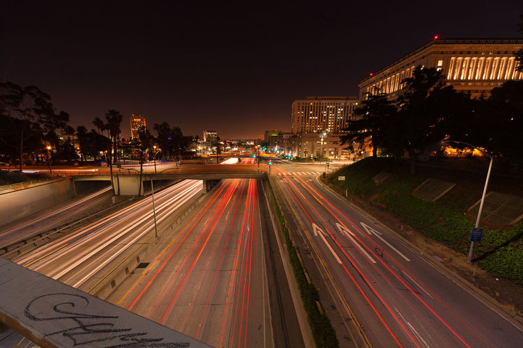 Light Trails On Highway In City Against Sky At Night